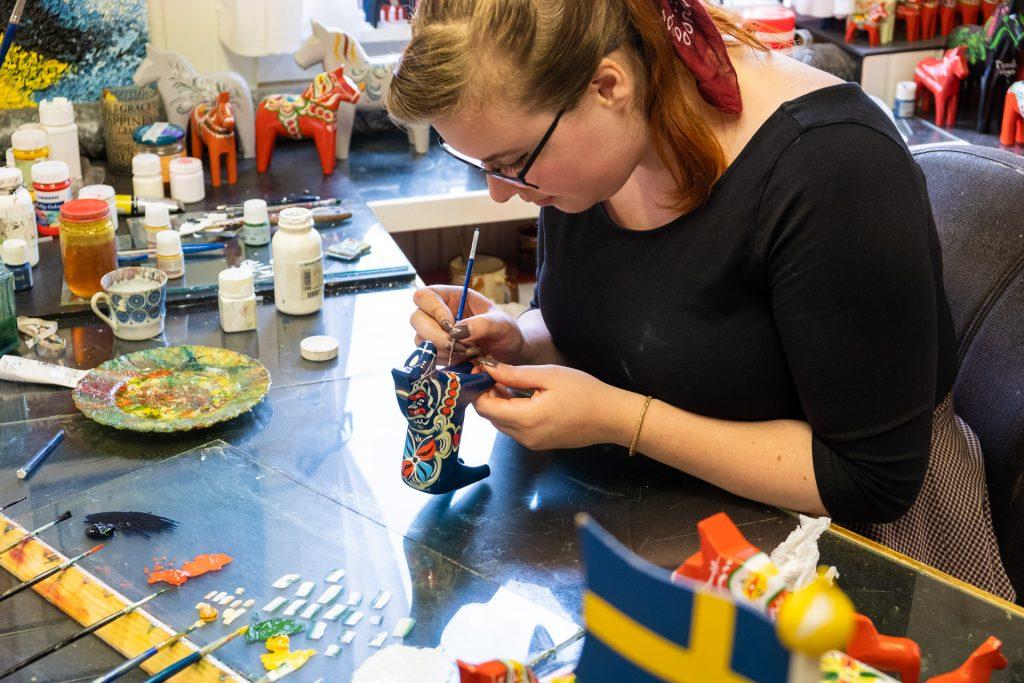 Making of traditional dalahäst dalahorse at Nils Olsson Dalahäster Dalarna Sweden